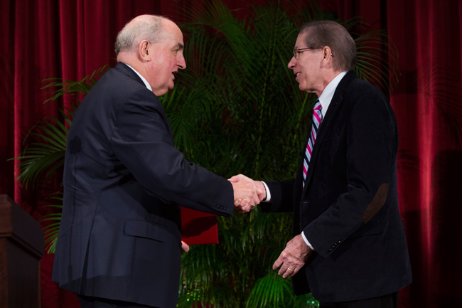 IU President McRobbie congratulates Christopher I. Beckwith on his honor of being named Distinguished Professor.