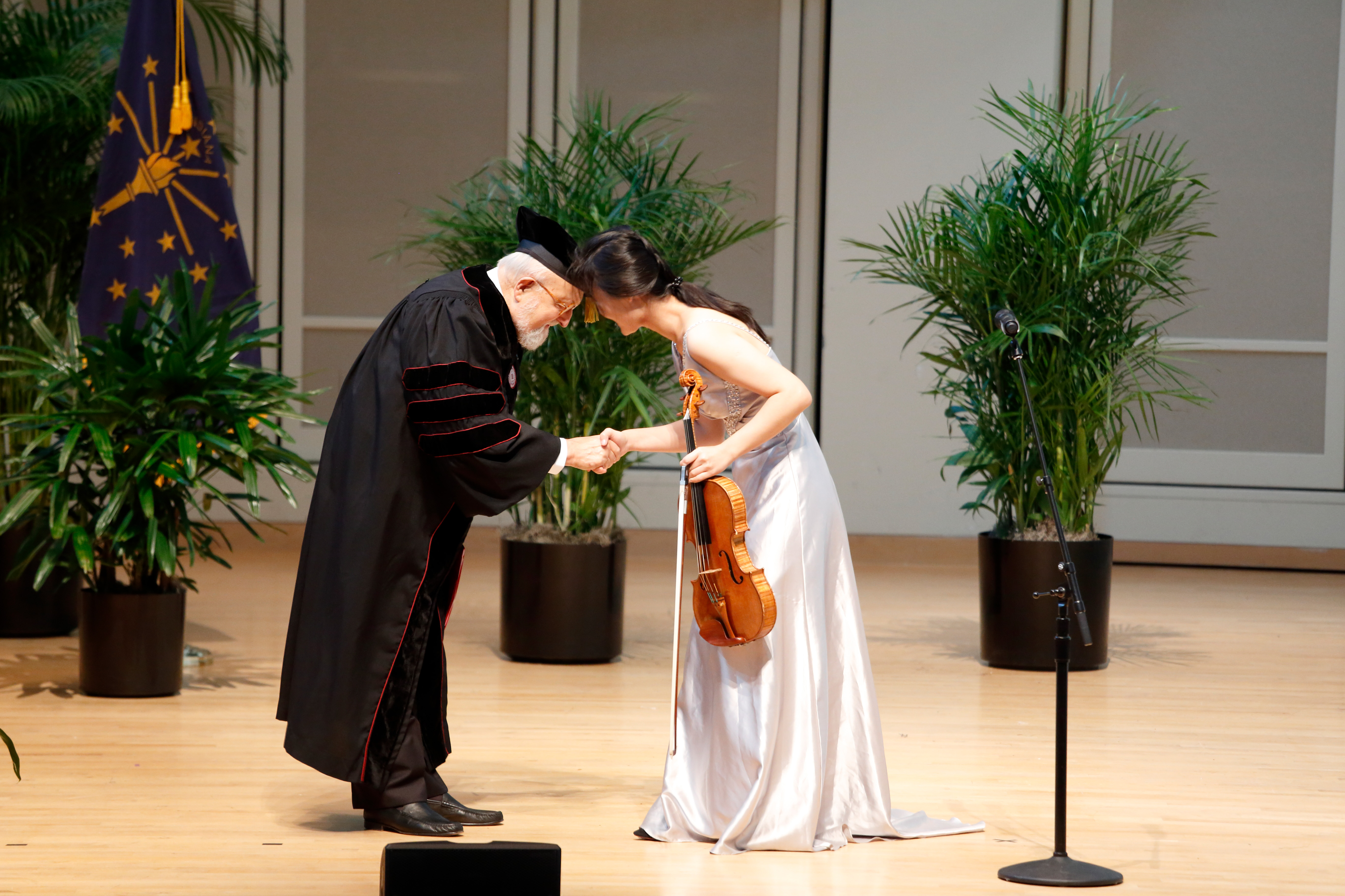 composer bows to violist after her performance of his composition